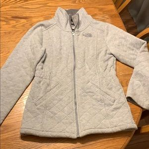 North face jacket worn a hand full of time